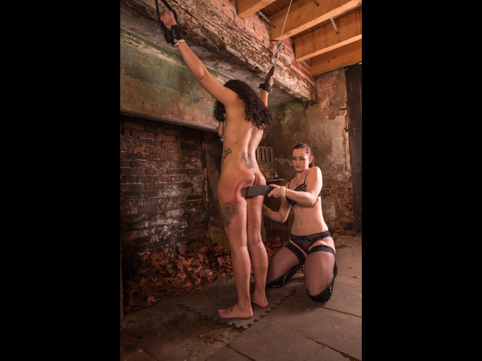 Slave Girl Spanking Paddle Leather Derby Dominatrix stockings