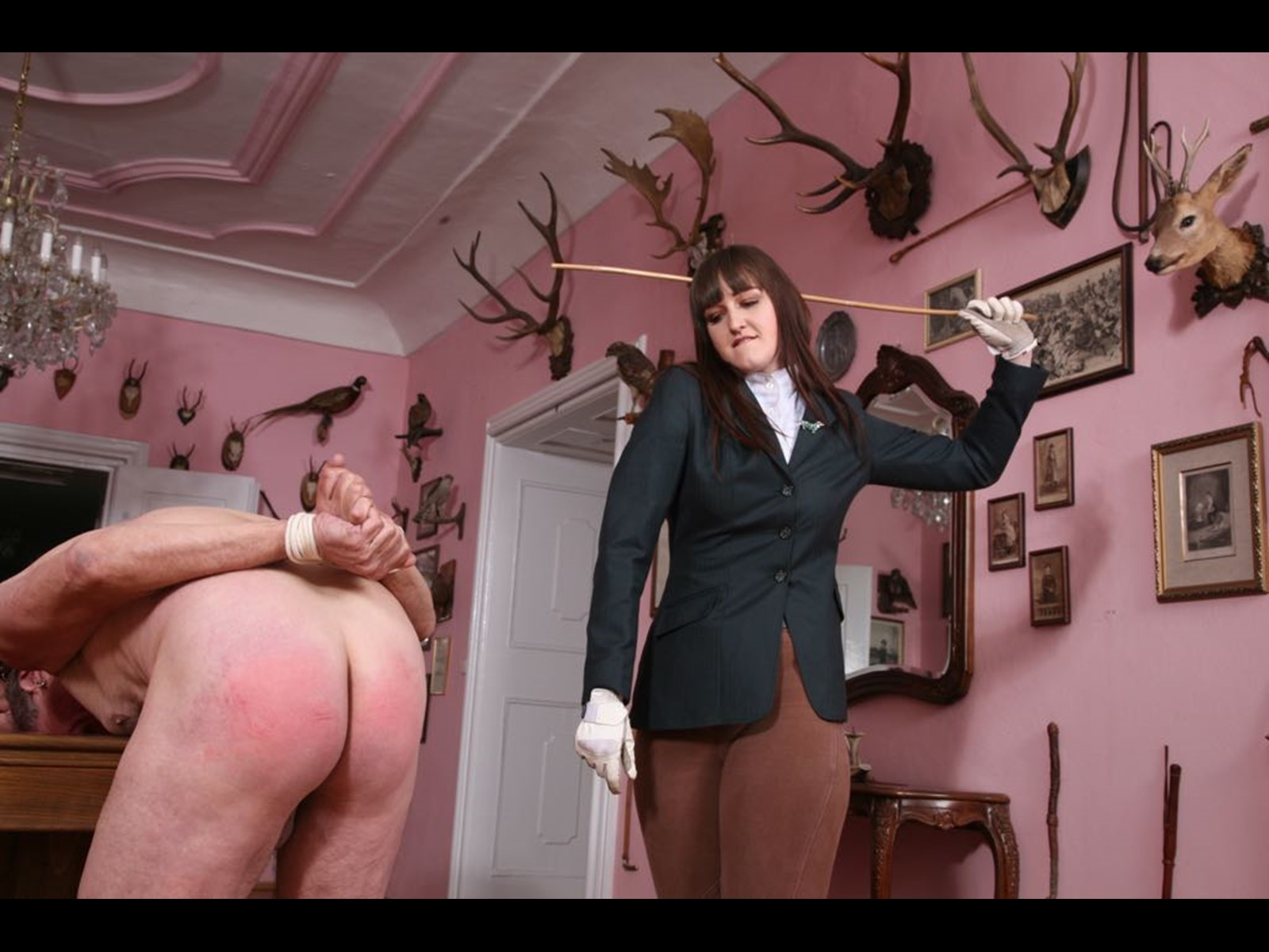 Caning a slave on the billiard table at the Other World Kingdom in Cz with Hunting Lodge and Taxidermy. Hard Caning