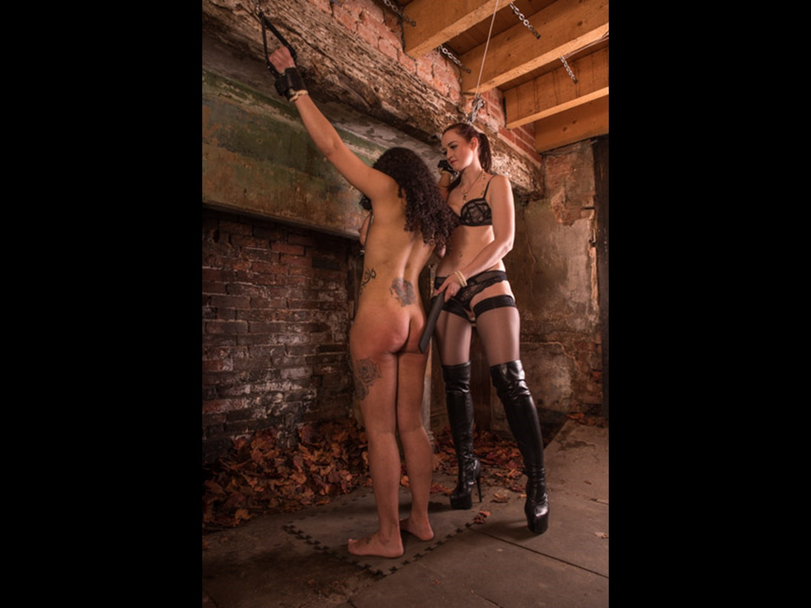Spanking trussed up and restrained slave girl White-Rabbit with a leather paddle until she cries