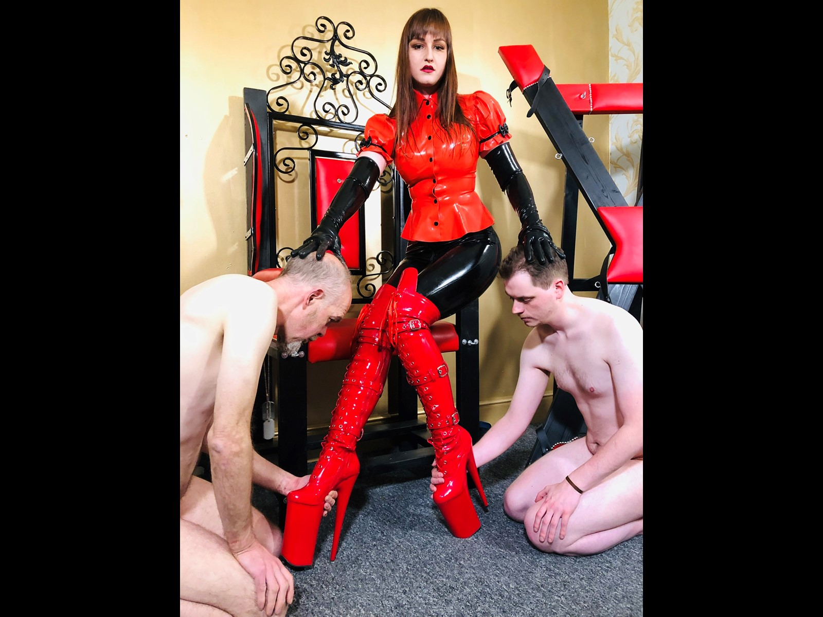 Goddess Vivienne Sits On Her Throne Whilst Two Naked slaves Worship Her Amazing Fetish Boots