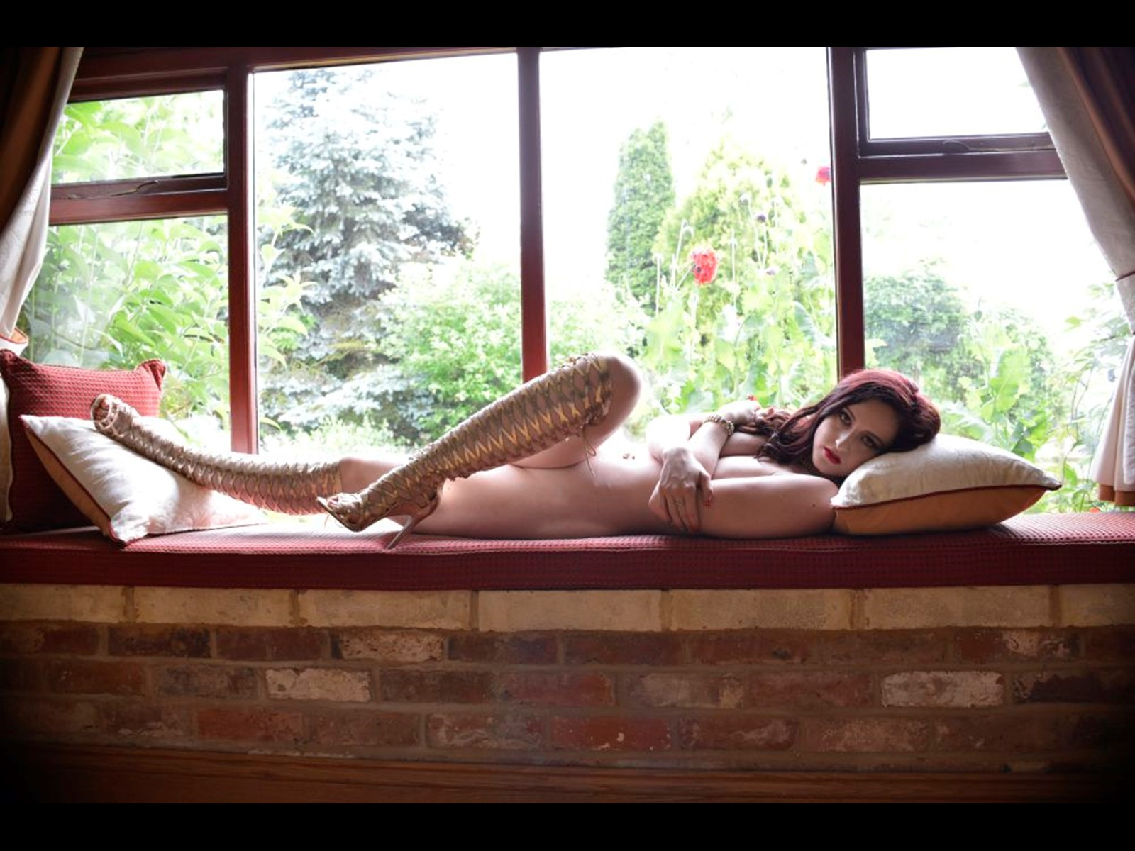 Reclining Empress Vivienne on the Windowsill, Nude and Wearing Only Her Gold Goddess Boots